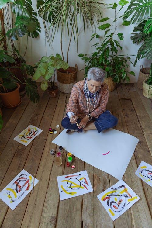 Woman In Blue Denim Jeans Sitting On Floor
