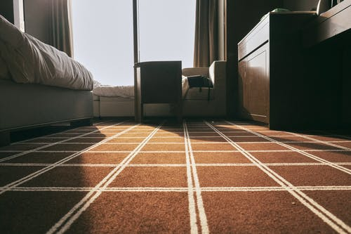 A Bedroom With Brown Carpet Floor