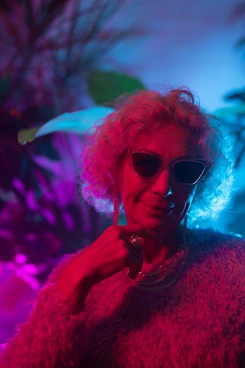 Portrait Photo of Elderly Womna Wearing Sunglasses