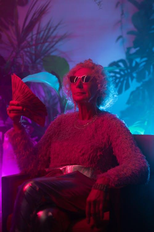 Photo of Stylish Grandma Holding Huge Amount of Money