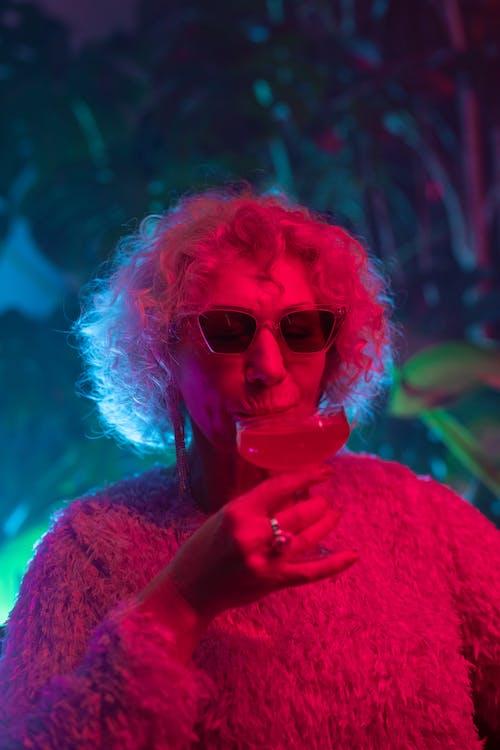 Photo of Chic Grandma Drinking Cocktail