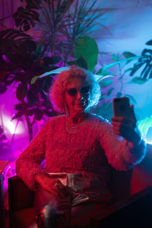Photo of an Elderly Woman Taking a Selfie