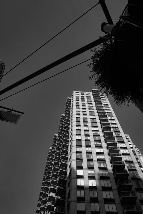 Grayscale Photo of High Rise Building