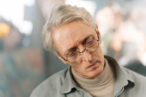 Kostenloses Stock Foto zu älterer erwachsener, auge, bokeh