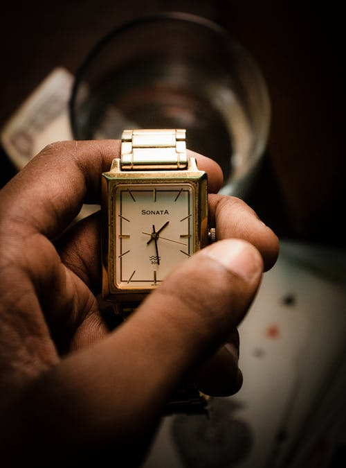 Close-Up Shot of a Person Holding a Wristwatch