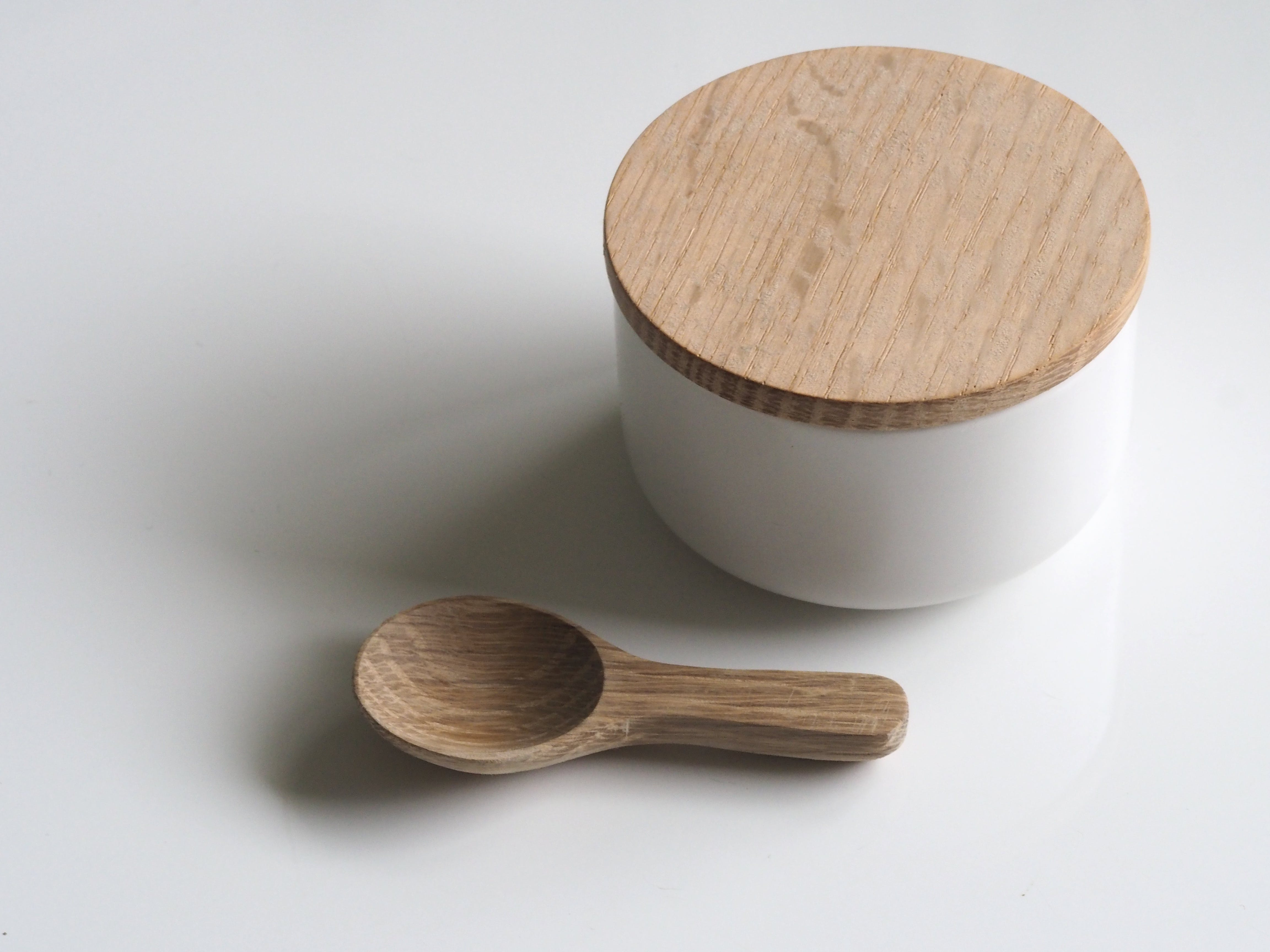 Close-up Photography of White and Brown Wooden Container and Spoon