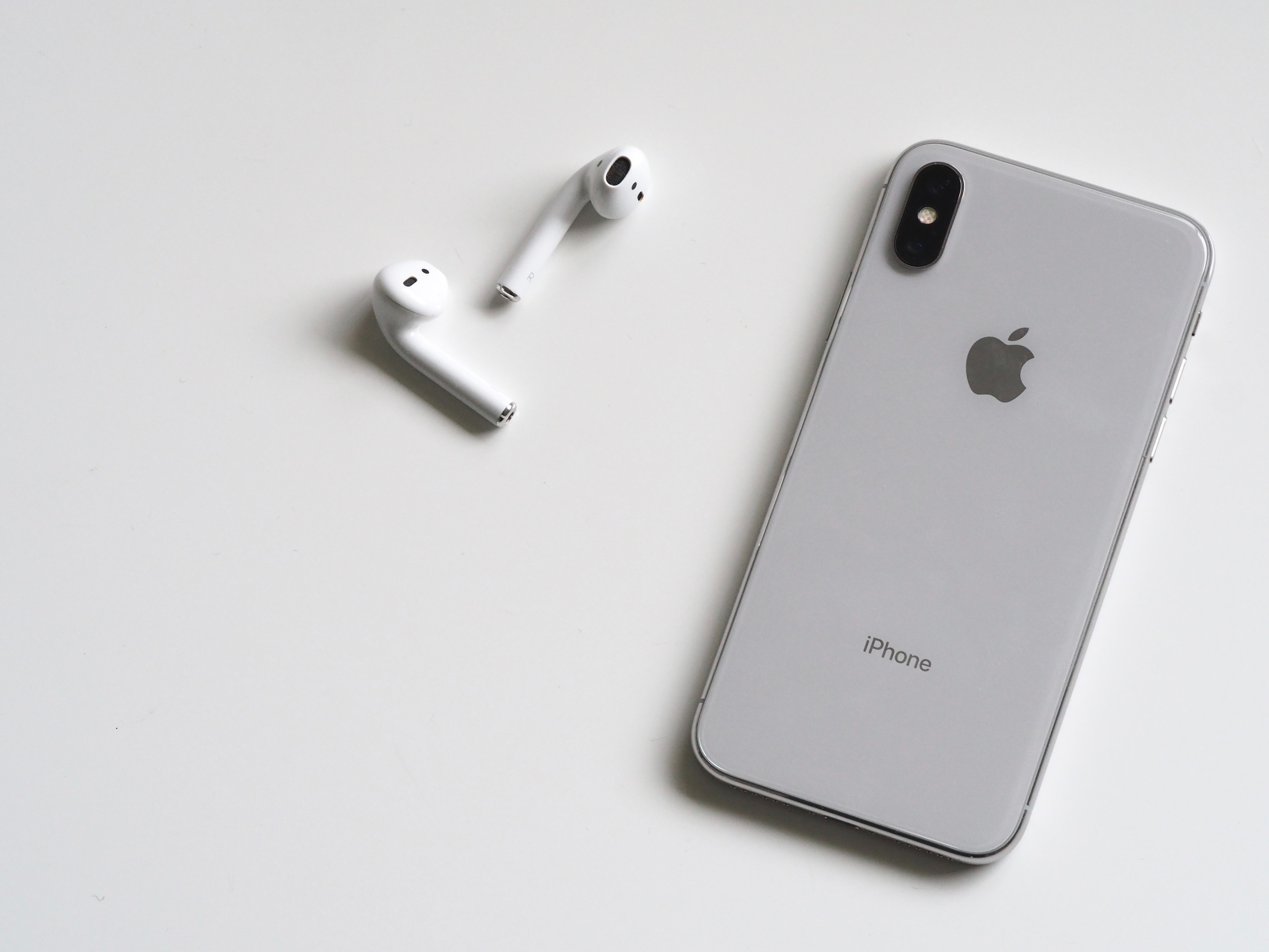 Silver Iphone X With Airpods Free Stock Photo