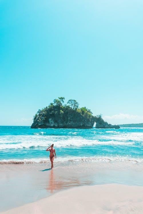 Woman in Red Bikini Walking on Beach