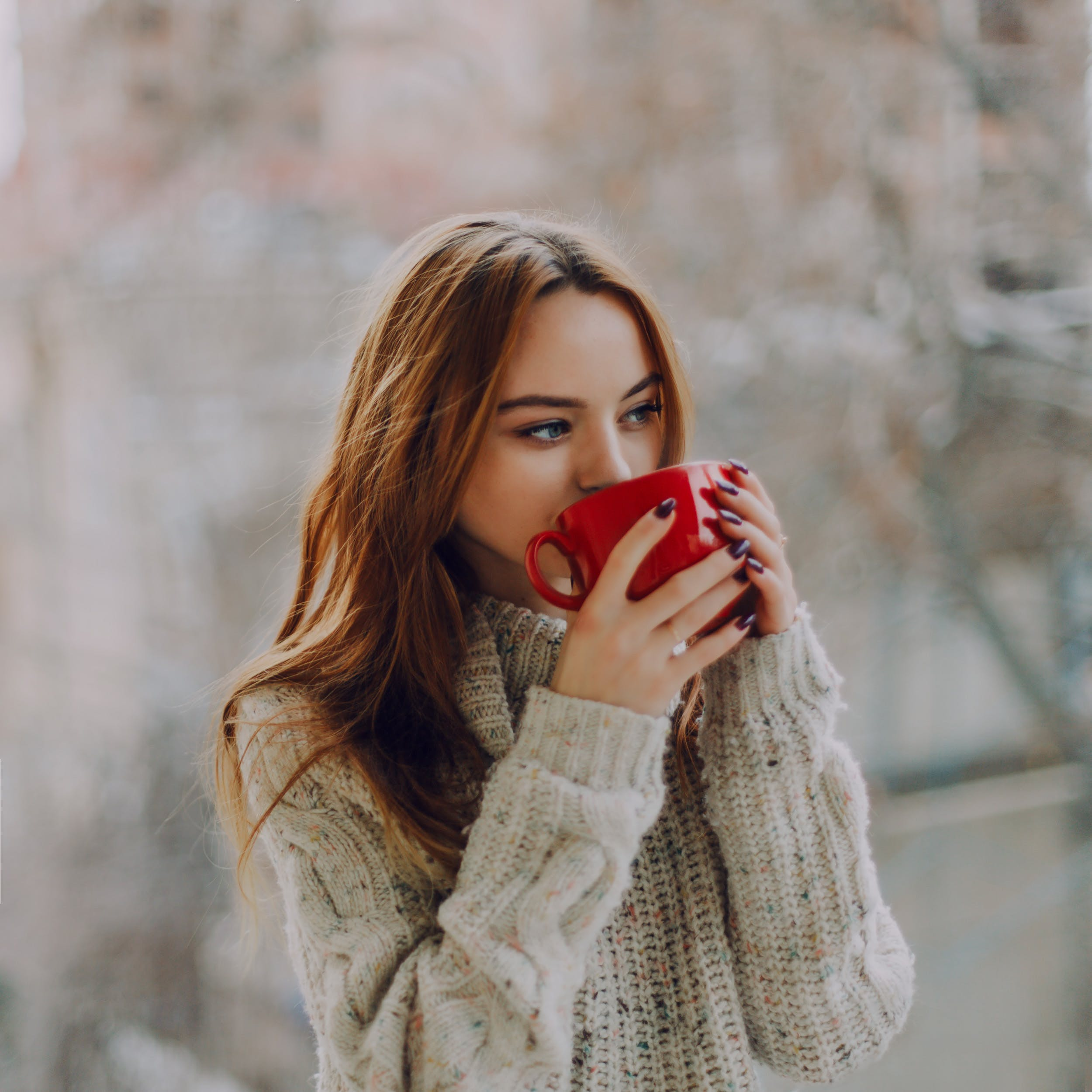 Selective Focus Photography of Woman Holding Red Ceramic Cup