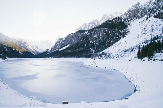 Landscape Photo of Lake Surrounded With Snow