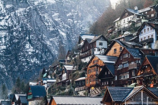 Assorted-color Wooden House on Mountain