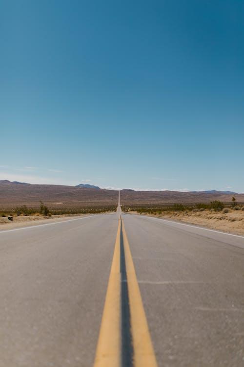Gray Concrete Road Under Blue Sky