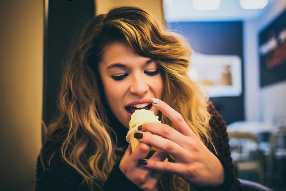 Long Blonde Haired Woman Eating Ice Cream