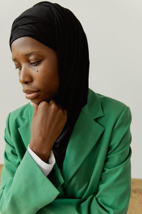 Woman in Green Blazer and Black Hijab