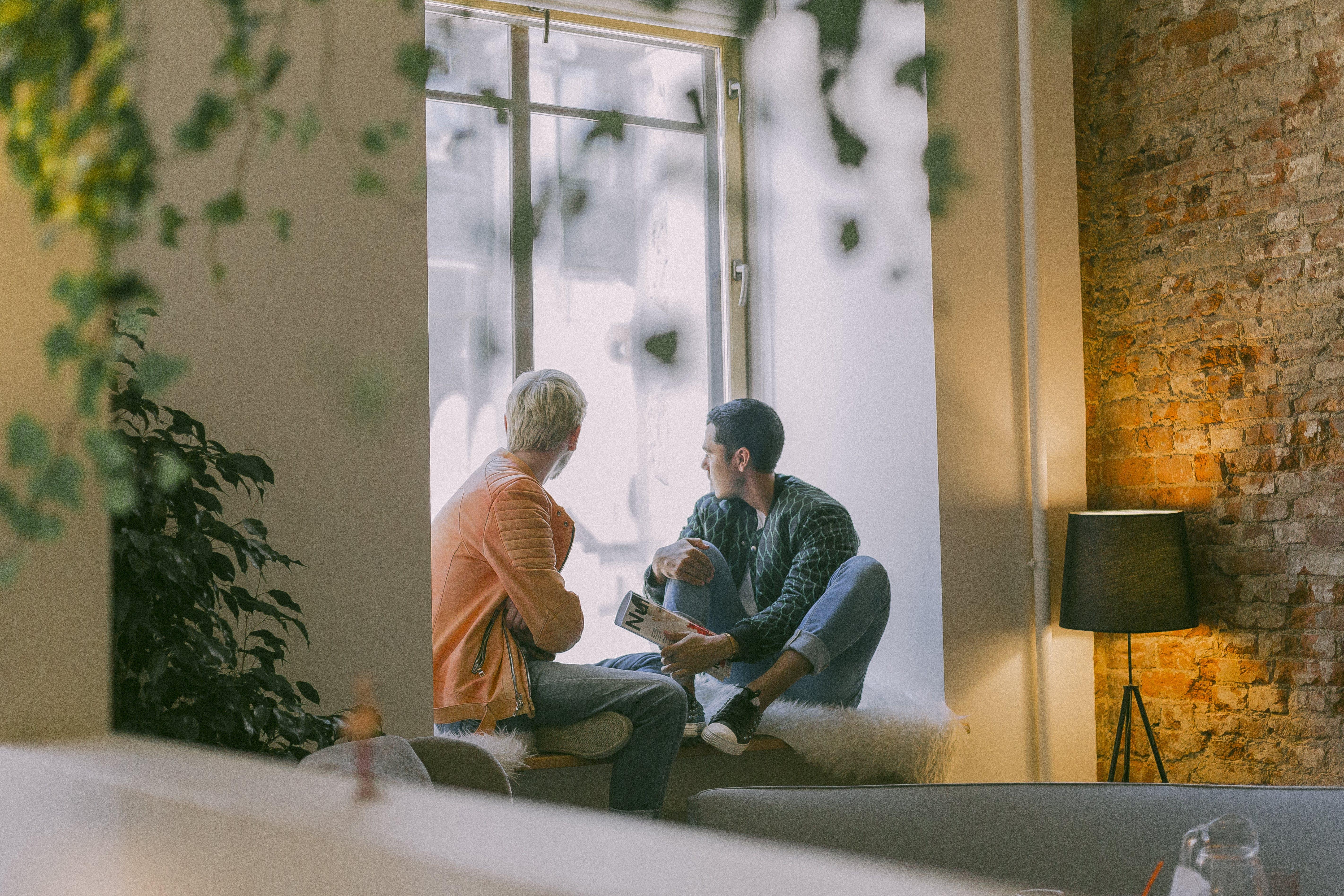 Two Men Near the Window Talking