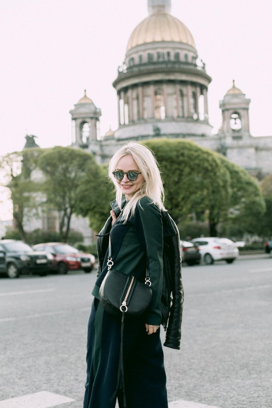 Women's Black Jacket and Black Skirt Near Building