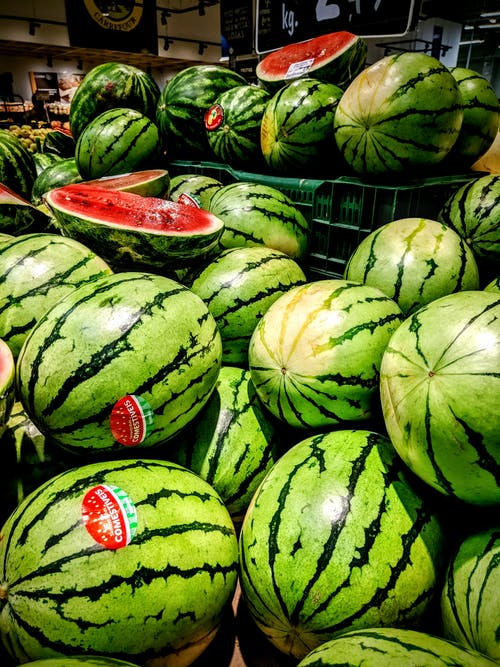 Watermelon Fruits on Gray Metal Rack