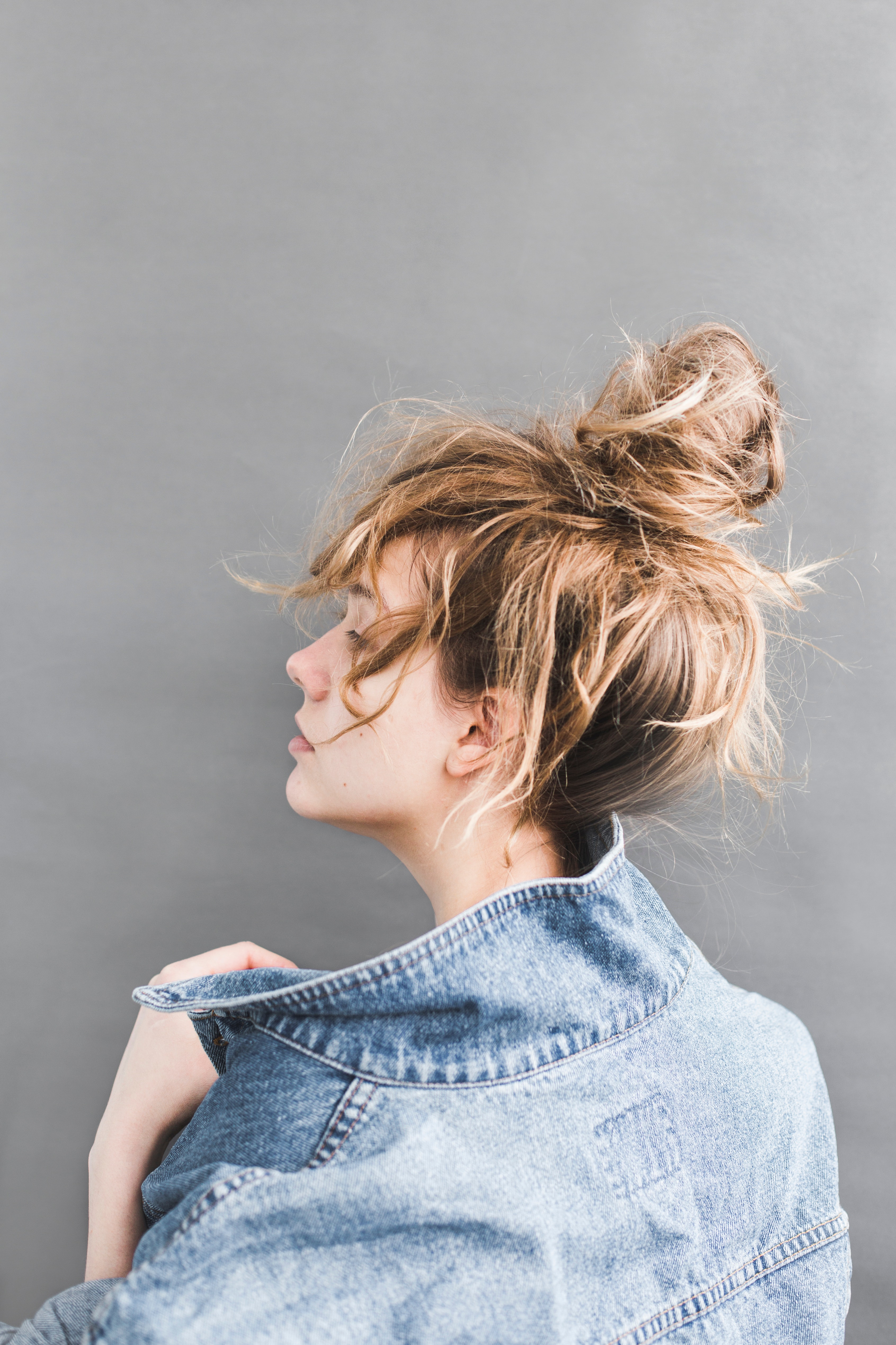 Back View Of Woman Holding Her Denim Jacket Free Stock Photo