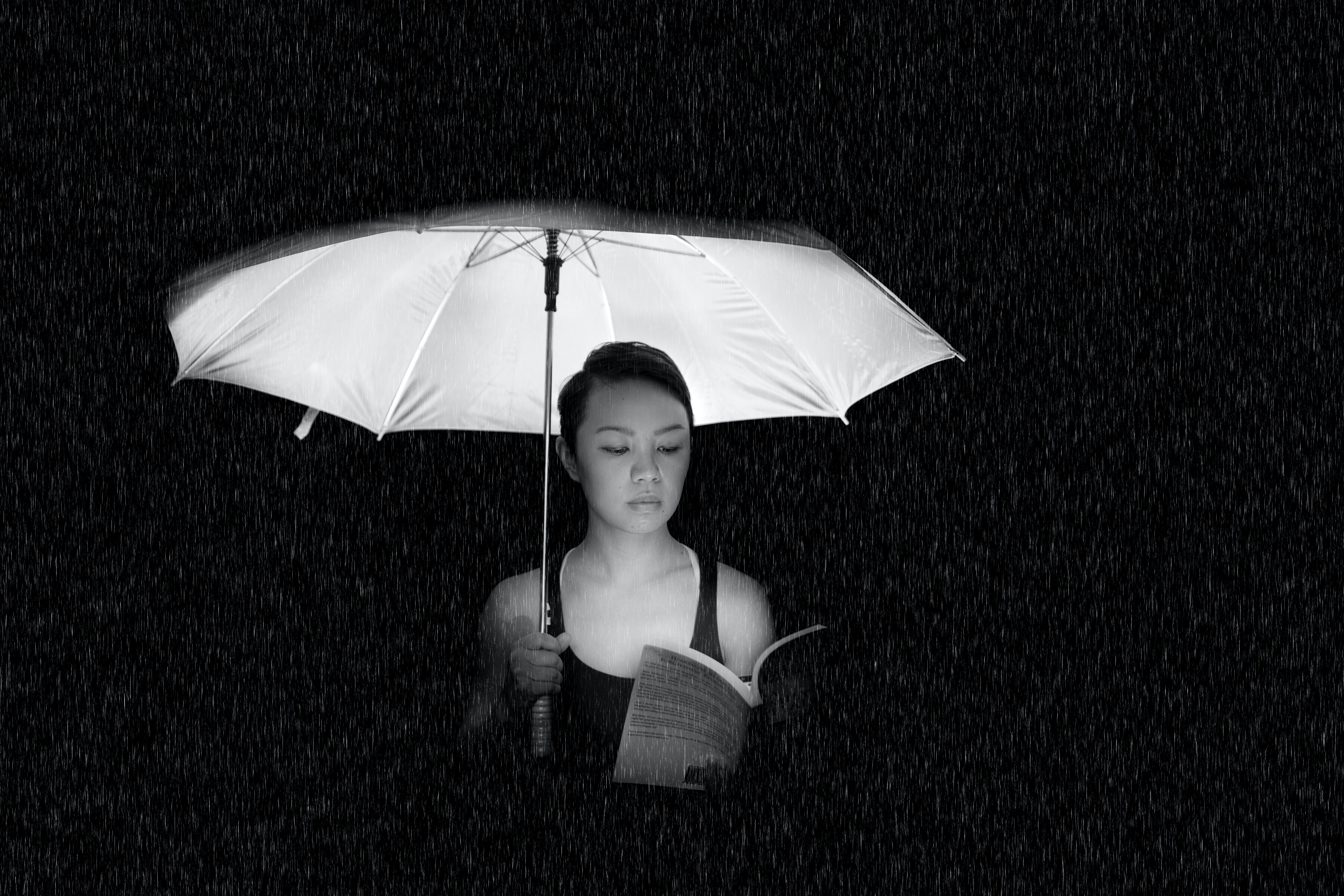Woman Holding an Umbrella Greyscale Photo