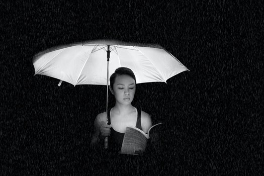 Woman Holding an Umbrella Greyscale Photo