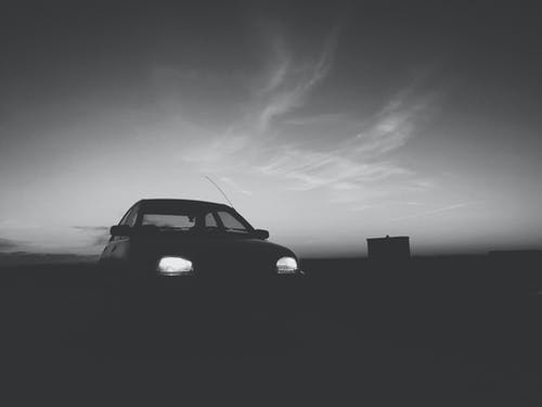 Silhouette Of Car With Turned On Light
