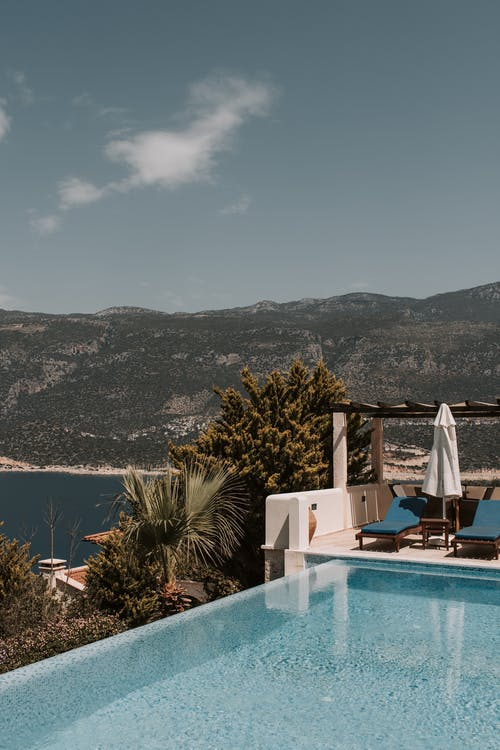 Swimming Pool With View Of Mountain And Sea
