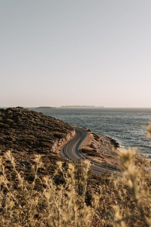 Gray Asphalt Road Near Body of Water