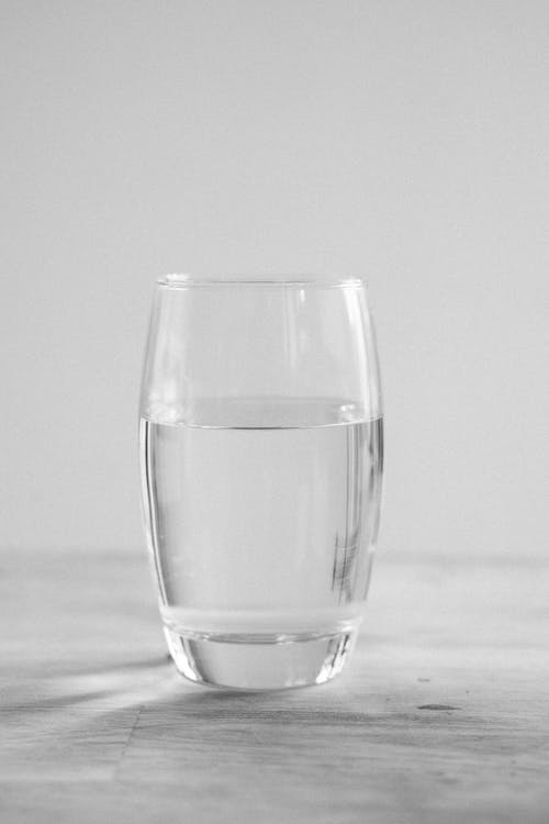 Clear Drinking Glass on Table