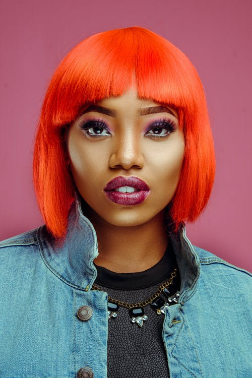 Stylish black woman with dyed hair