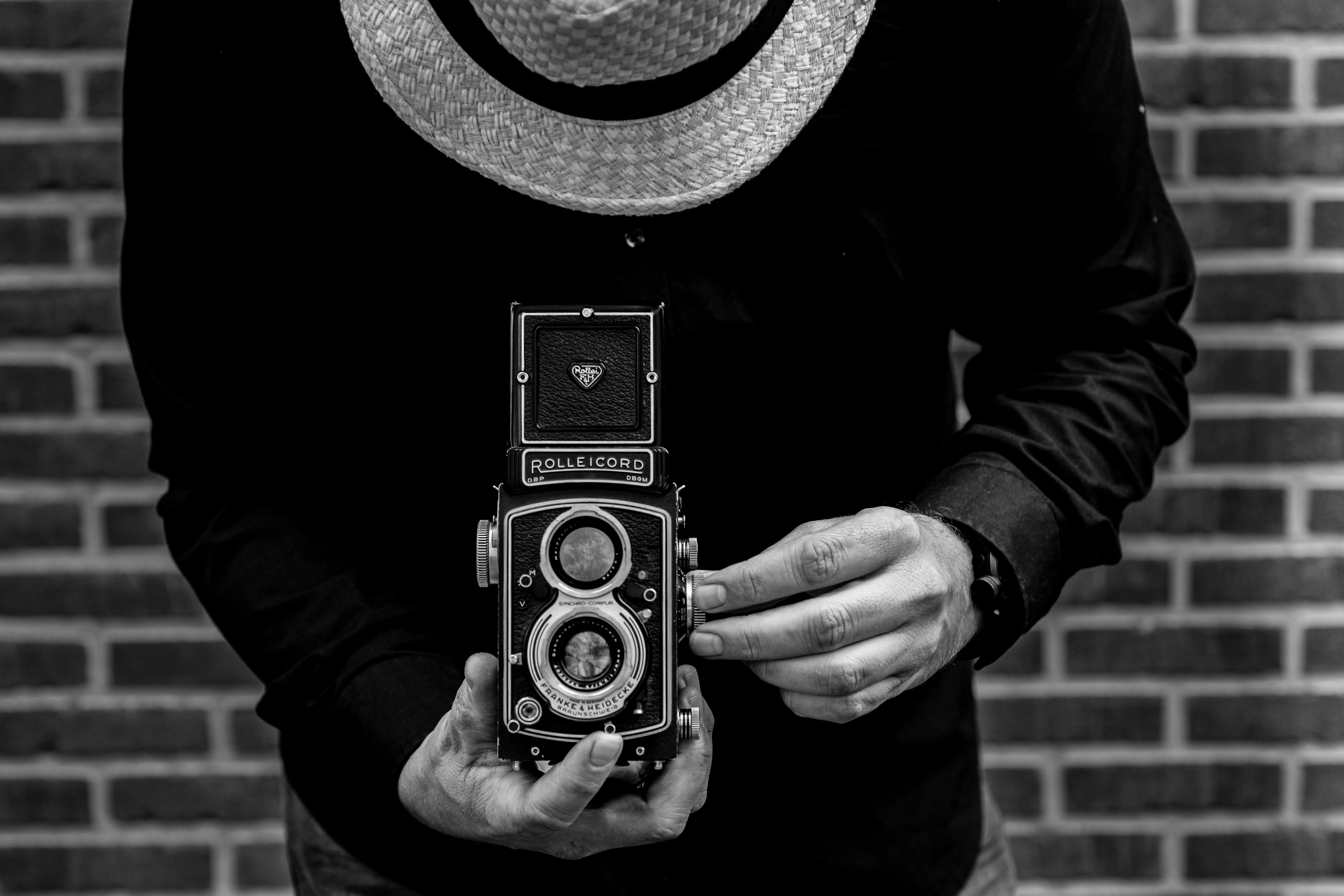 Photo of Person Holding Vintage Camera