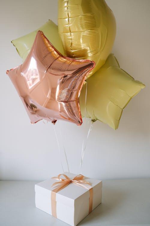 Yellow Balloon on White Wall