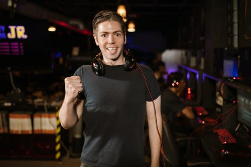Man in Black Shirt Wearing Black Headphones