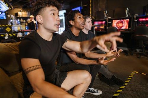 Men Playing Video Game