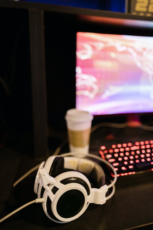 Shallow Focus Photo of White Headphones