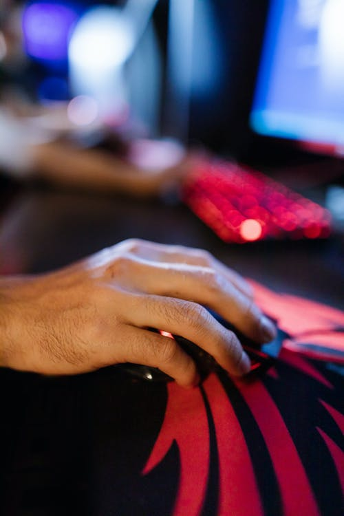 Close-Up View of a Person Holding a Gaming Mouse