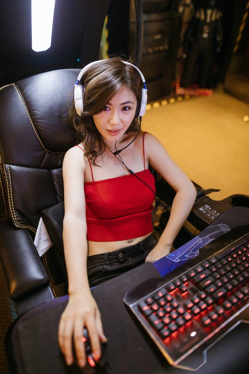 A Woman Sitting while Playing Computer Game