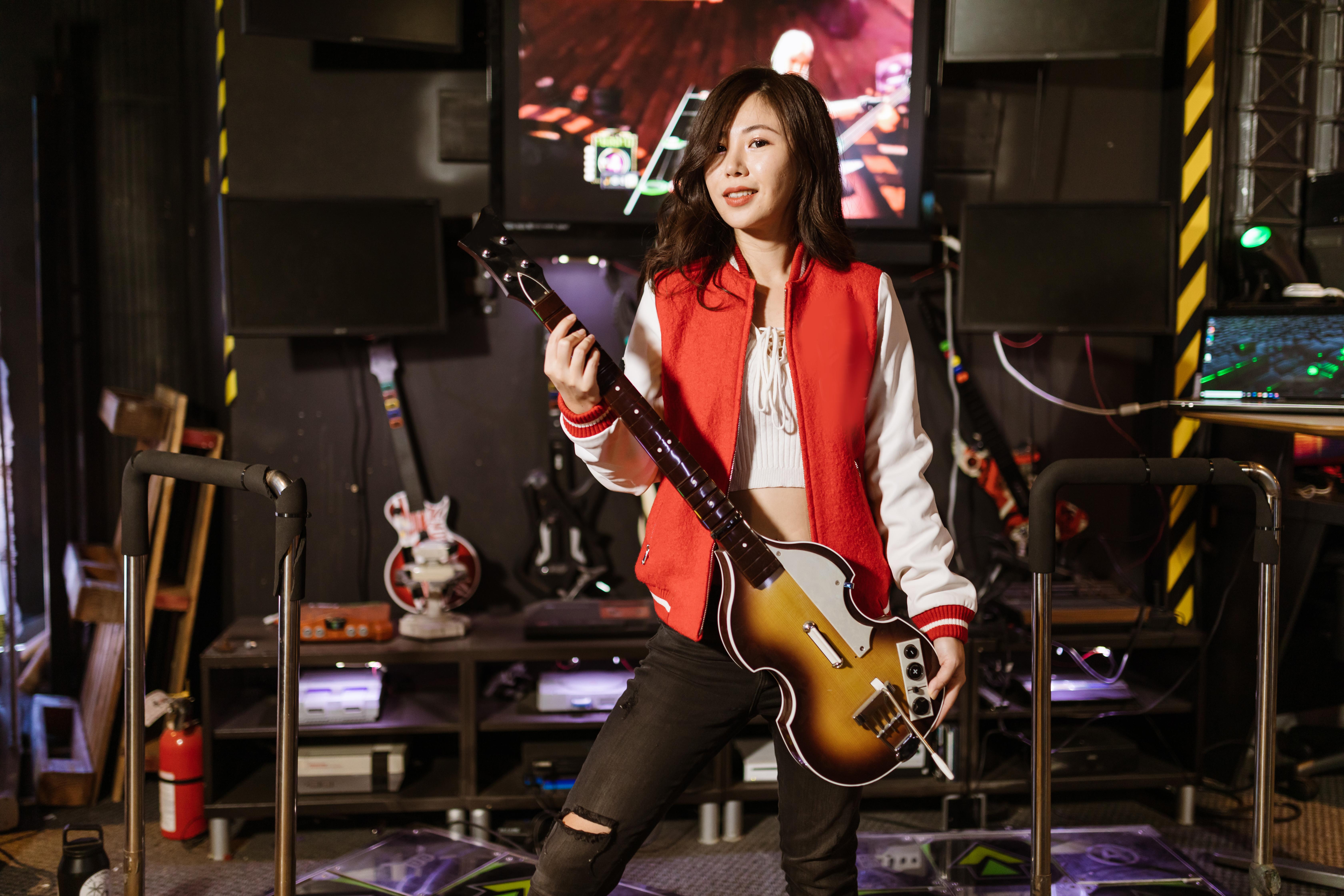 woman holding guitar controller