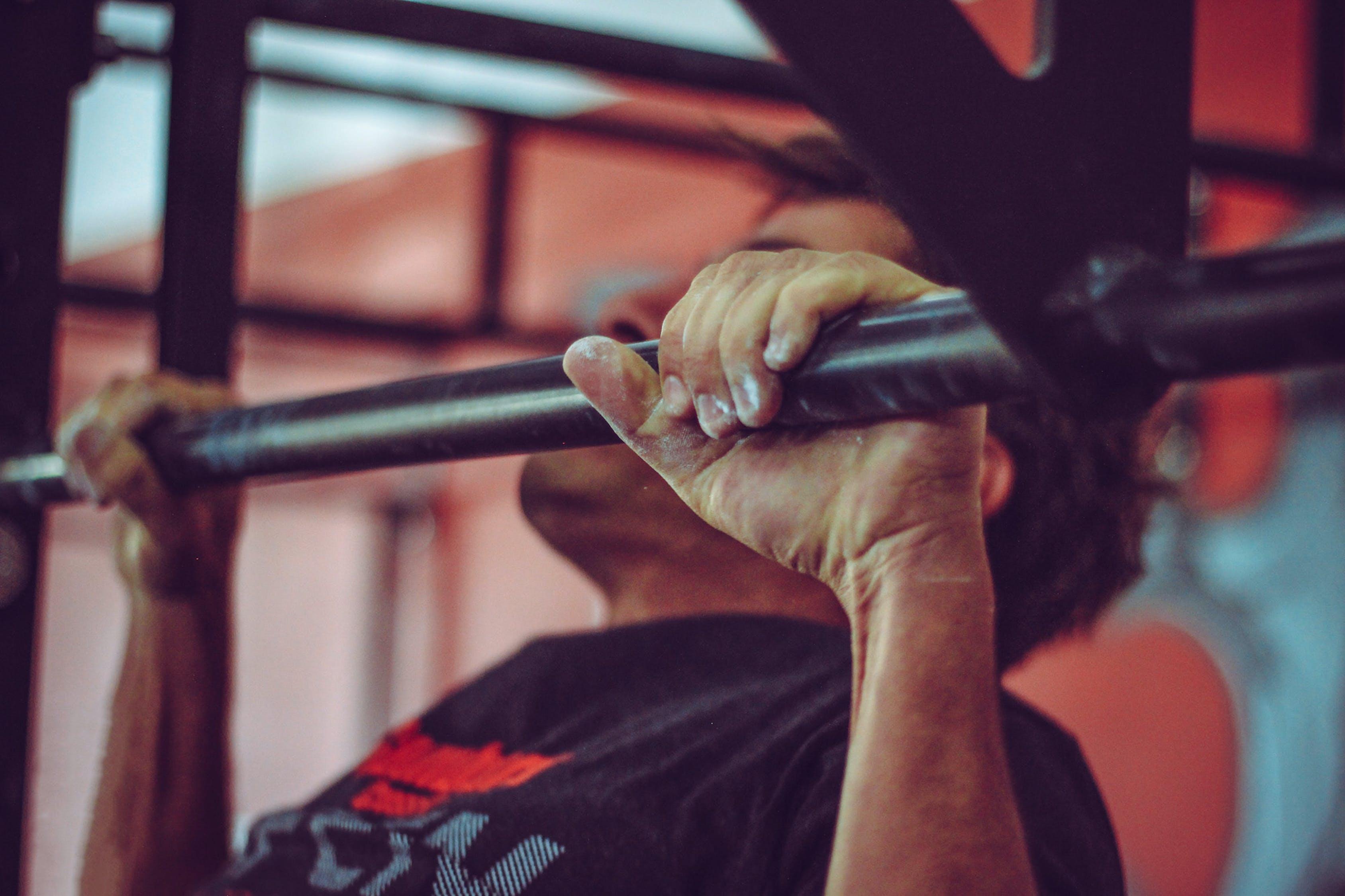 Man In Black Crew-neck Shirt Doing Pull-ups