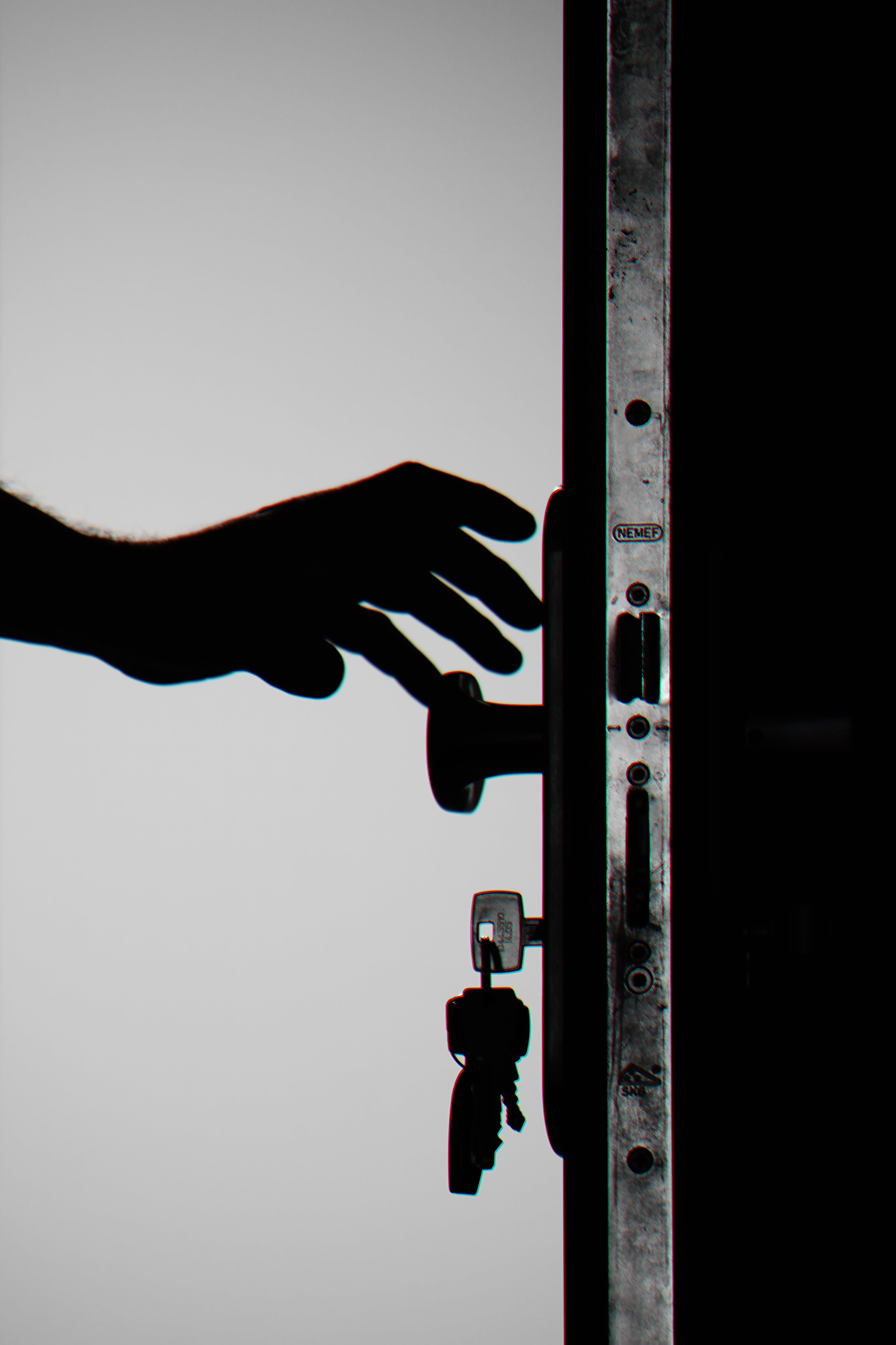 Silhouette Photo of Person Holding Door Knob