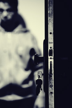 Monochrome Photo of Keys and Door Knob