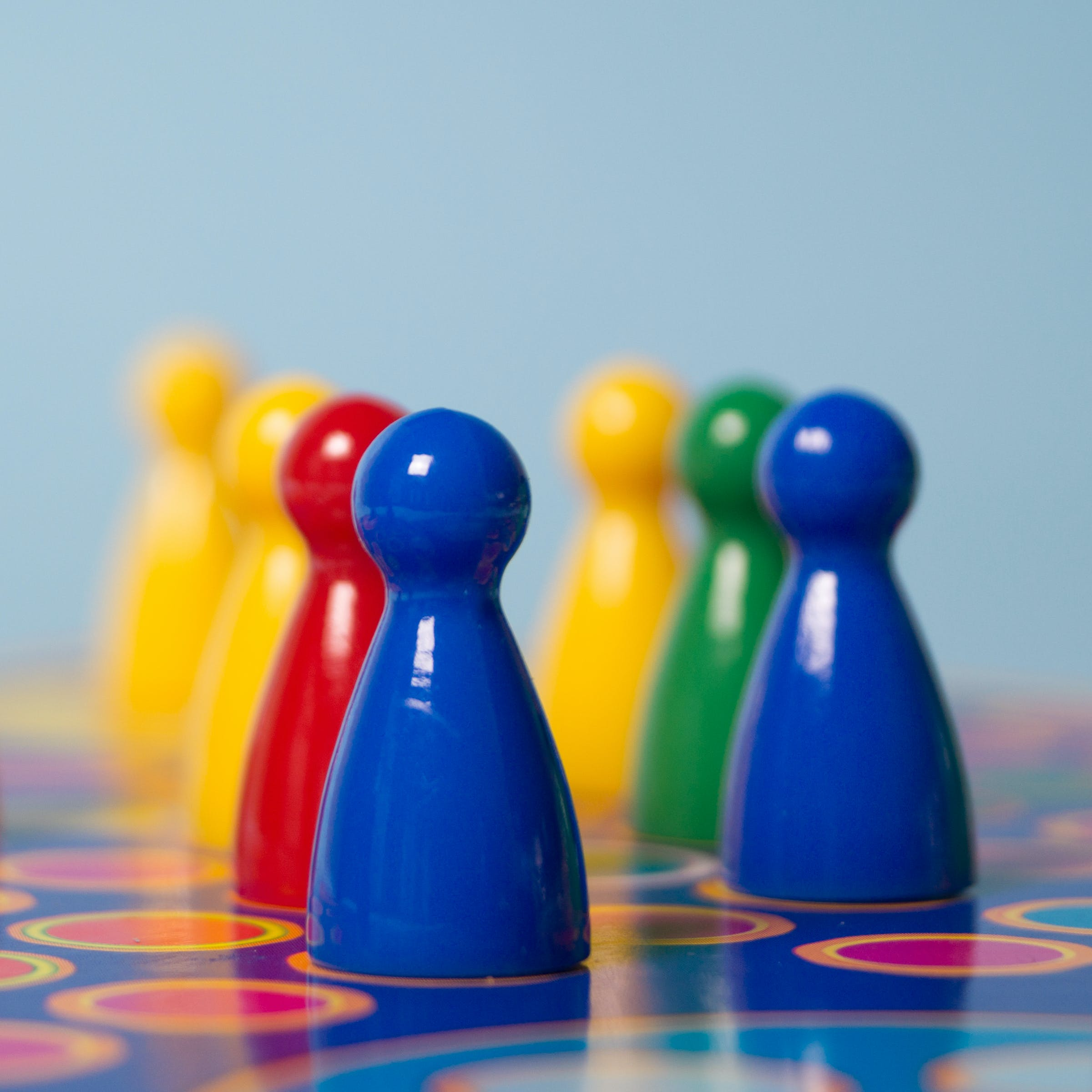 Closeup Photography of Yellow, Red, Green, and Blue Chess Piece