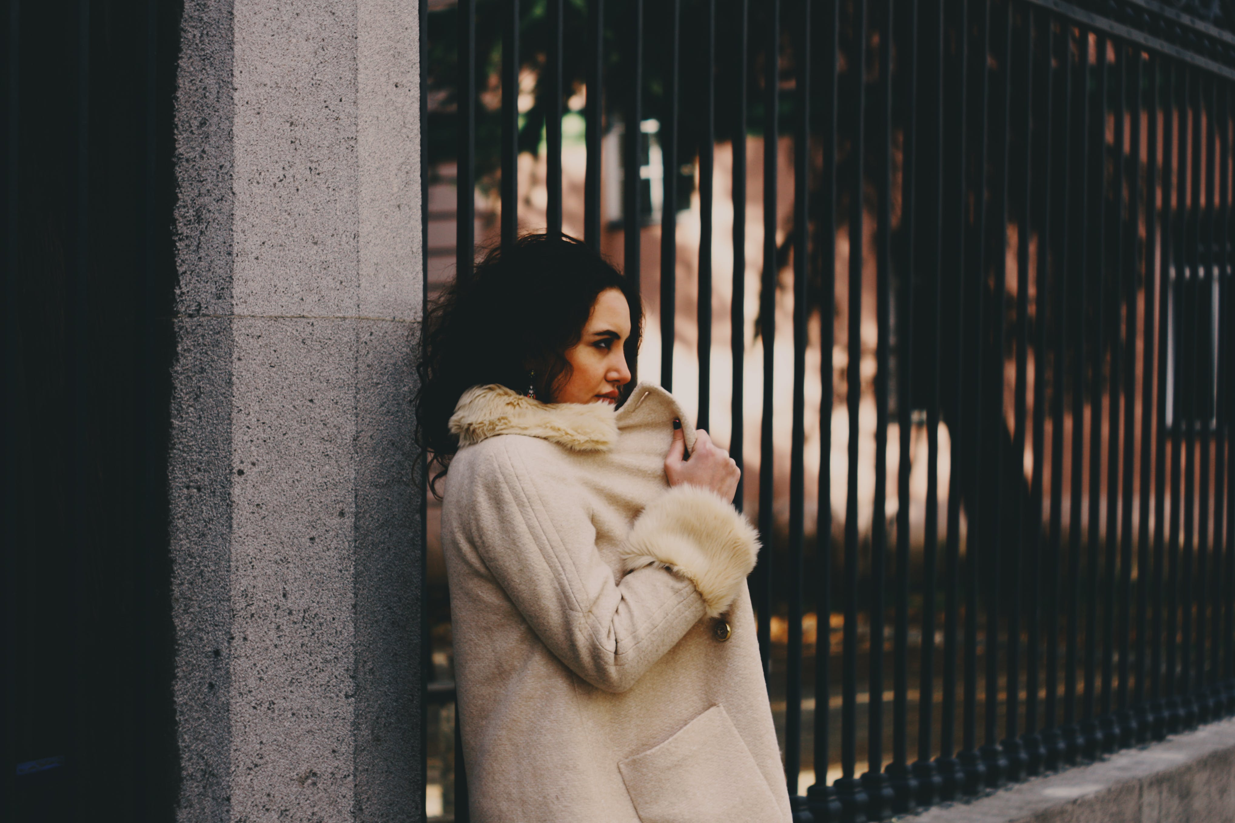Woman Wearing White Fur Coat