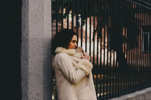 Woman Wearing White Fur Coat