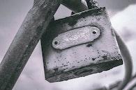 Macro Photography of Gray Metal Padlock on Gray Metal Bar