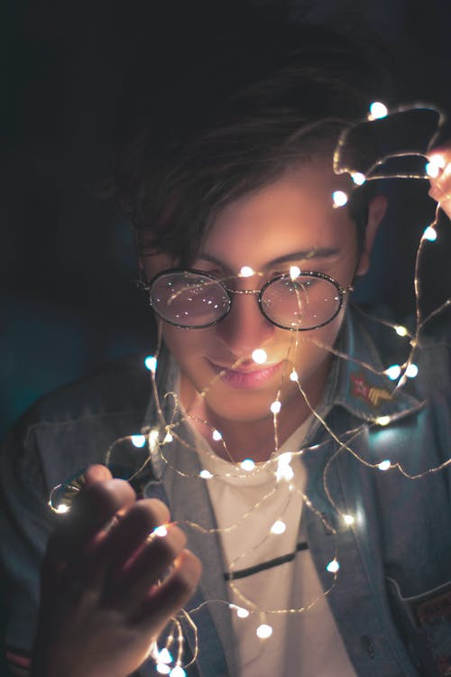 Photography of Man Wearing Eyeglasses