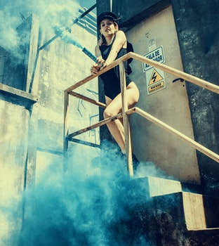 Woman in Black One Piece Swimsuit on Stairs
