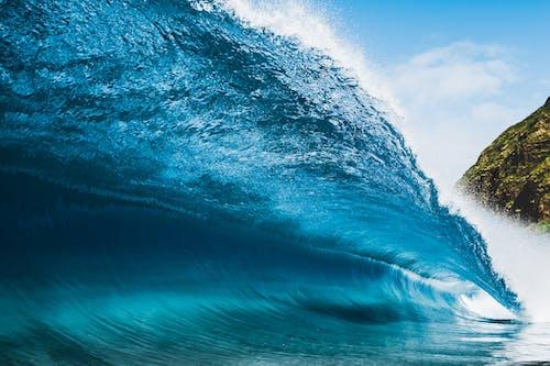 Ocean Waves Under Blue Sky