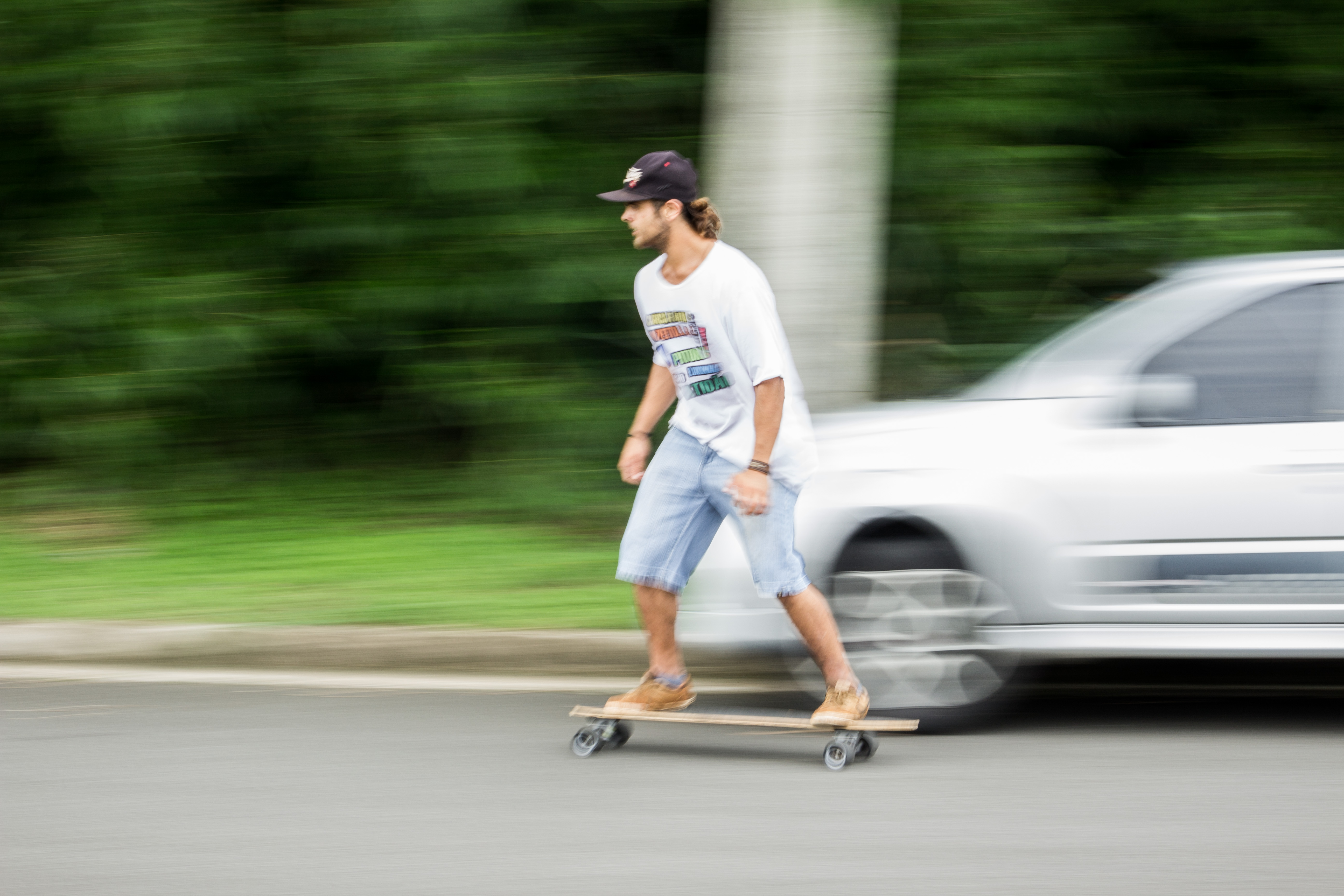 Man Playing Longboard on Road