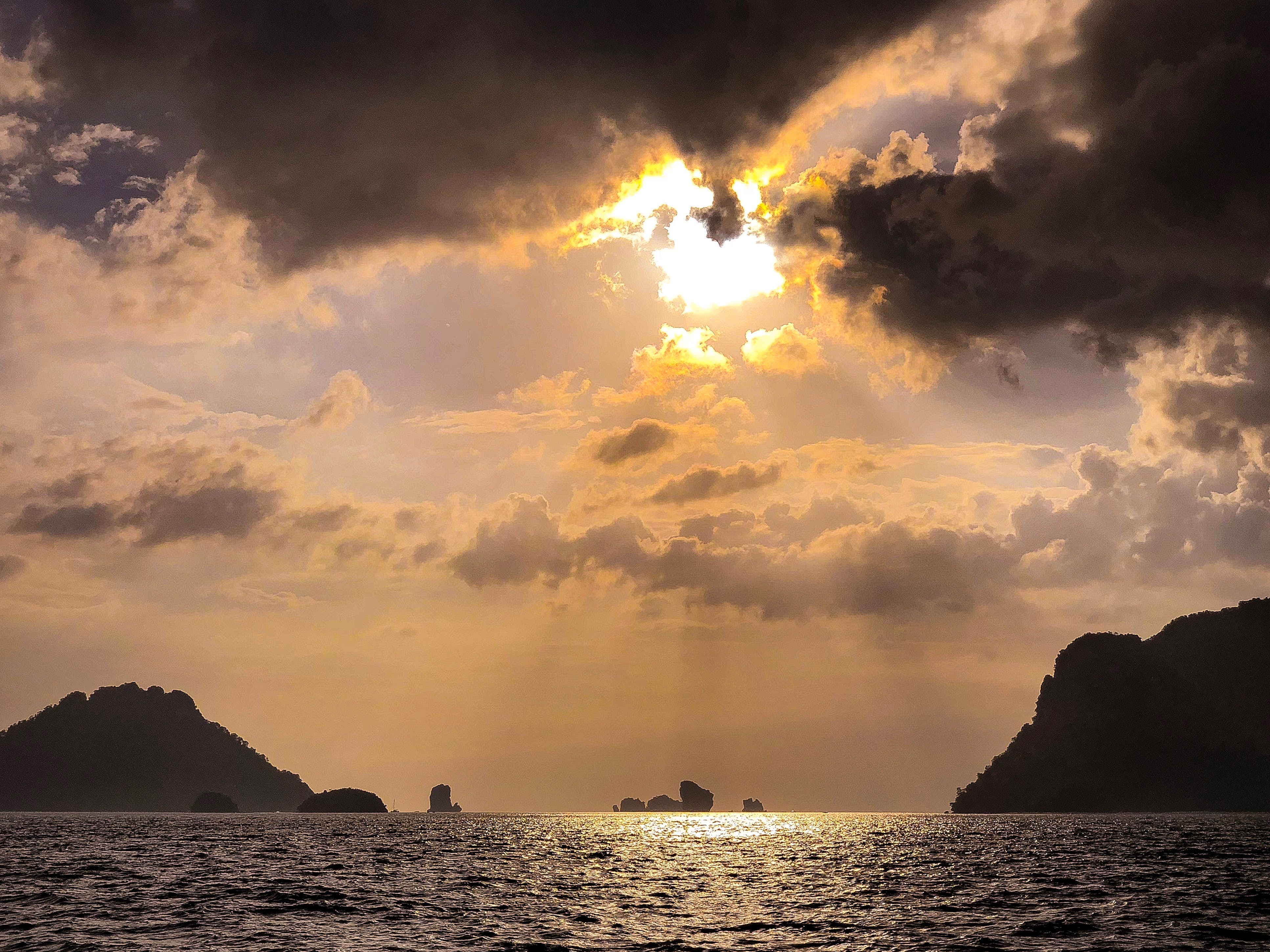 Sun Rays over Sea With Islands