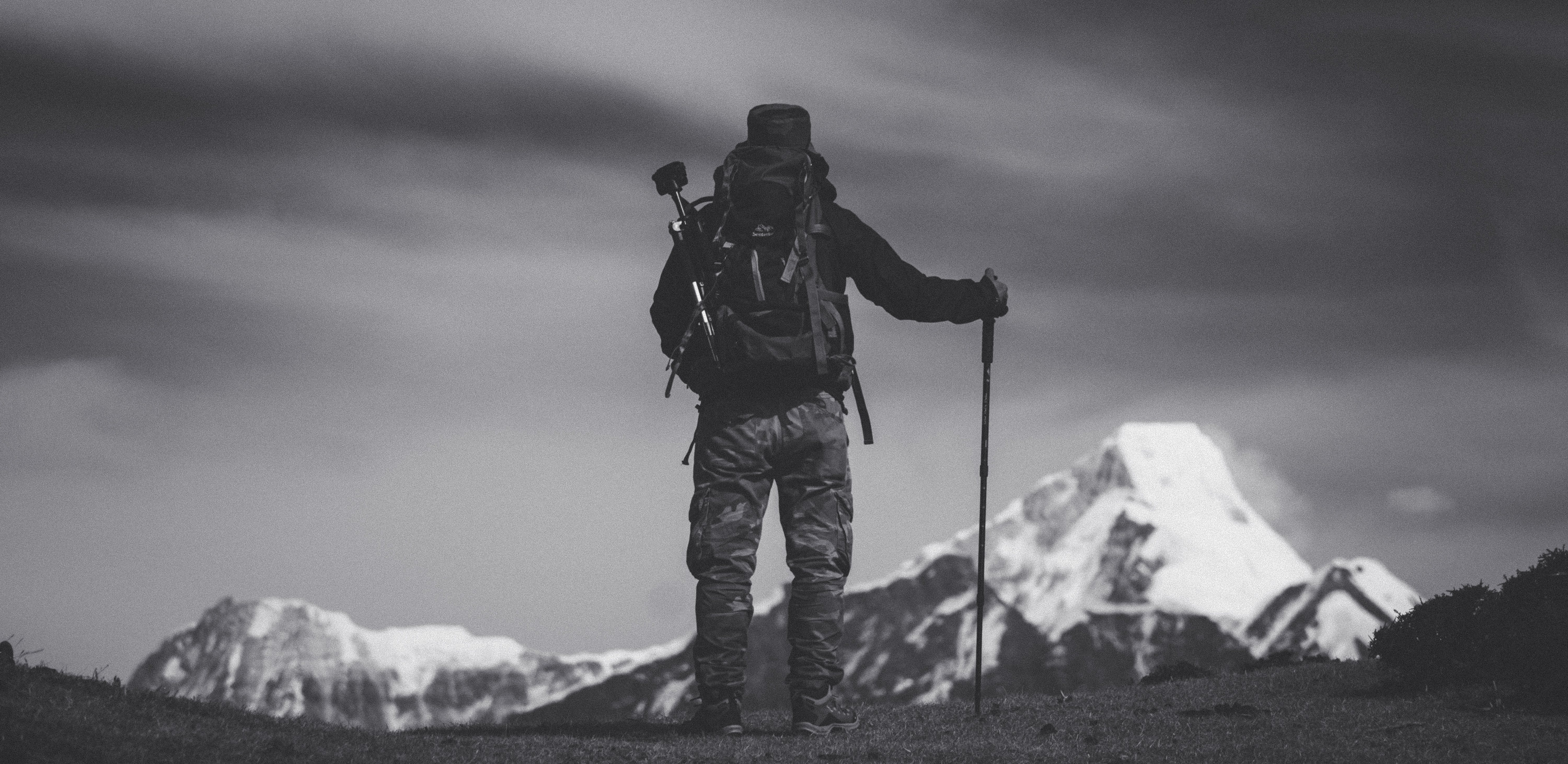 Grayscale Photo of Man Standing on Ground